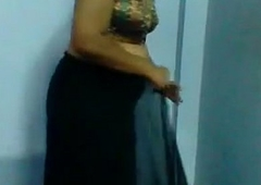 Mature Indian Woman Getting Dressed